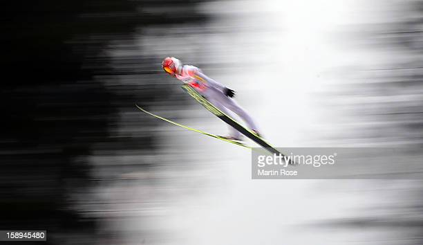 Kamil Stoch of Poland competes during the trial round for the FIS Ski Jumping World Cup event of the 61st Four Hills ski jumping tournament at...