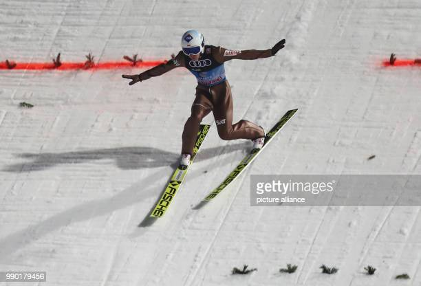 Kamil Stoch of Poland in action during his jump in the second round at the 66th Four Hills Tournament in Bischofshofen Austria 6 January 2018 Stoch...
