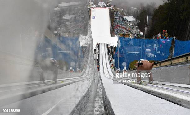 Kamil Stoch of Poland jumps during the ski jumping training round of the third stage at the 66th Four Hills Tournament in Innsbruck Austria on...