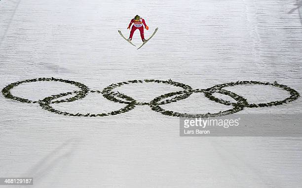 Kamil Stoch of Poland jumps in the Men's Normal Hill Individual Final on day 2 of the Sochi 2014 Winter Olympics at the RusSki Gorki Ski Jumping...