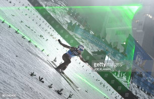 Kamil Stoch of Poland lands during the qualification for the fourth and final stage of the FourHills Ski Jumping tournament in Bischofshofen Austria...