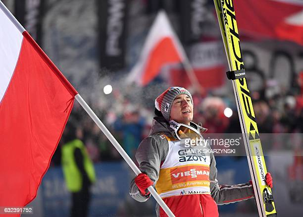 TOPSHOT Kamil Stoch of Poland reacts after he won the competition of FIS Ski Jumping World Cup in Zakopane Poland on January 22 2017 / AFP / Janek...