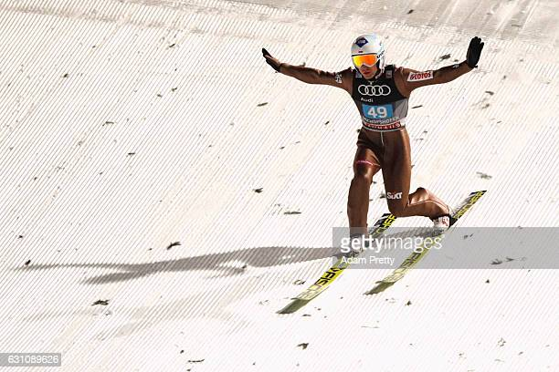 Kamil Stoch of Poland reacts at the final round on Day 2 of the 65th Four Hills Tournament ski jumping event at PaulAusserleitnerSchanze on January 6...