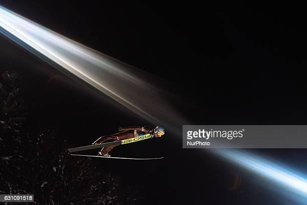 Kamil Stoch of Poland soars through the air during his first competition jump on Day 2 on January 6 2017 in Bischofshofen Austria
