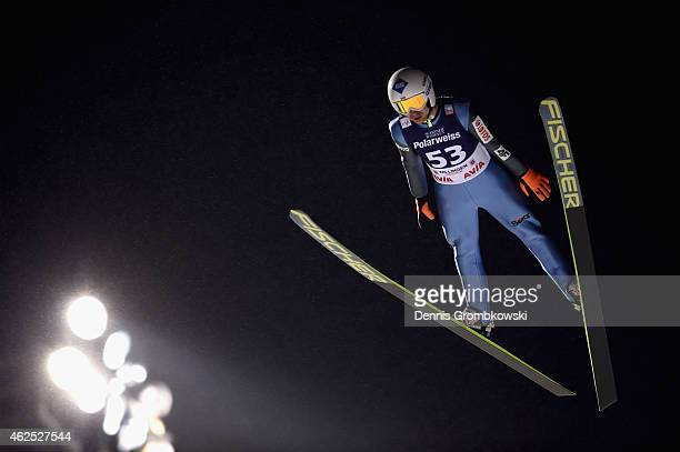Kamil Stoch of Poland soars through the air during his first round jump on Day One of the FIS Ski Jumping World Cup on January 30 2015 in Willingen...