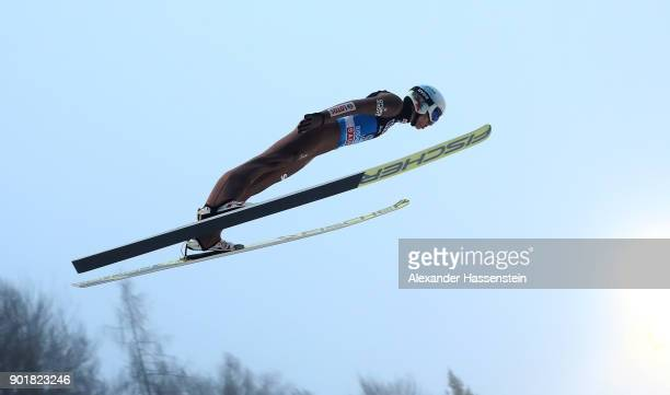 Kamil Stoch of Poland soars through the air during his practice jump of the FIS Nordic World Cup Four Hills Tournament on January 6 2018 in...
