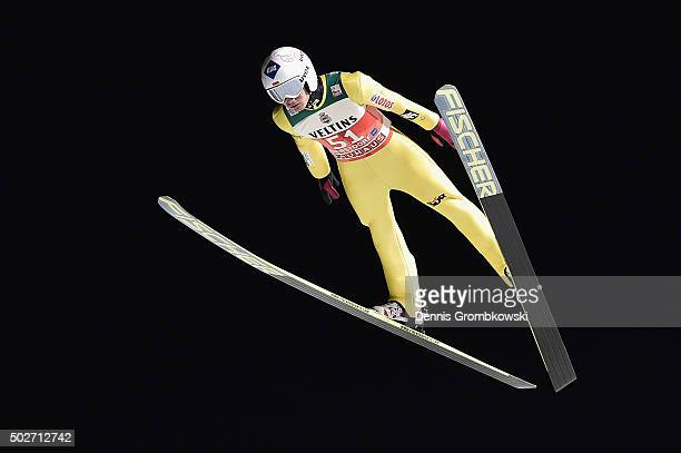 Kamil Stoch of Poland soars through the air during his qualification jump on Day 1 of the 64th Four Hills Tournament ski jumping event on December 28...