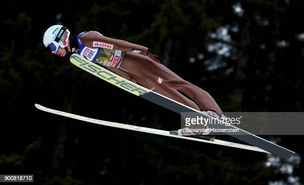 Kamil Stoch of Poland soars through the air during his qualification jump on day one of the Innsbruck 65th Four Hills Tournament on January 3 2018 in...