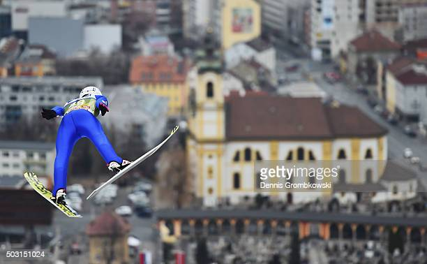 Kamil Stoch of Poland soars through the air during his training jump on day 1 of the 64th Four Hills Tournament ski jumping event on January 2 2016...