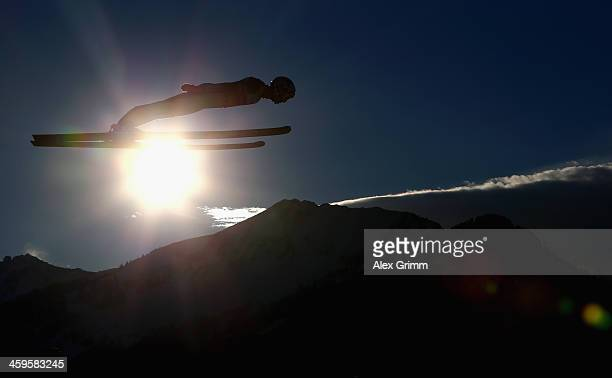 Kamil Stoch of Poland soars through the air during the training round on day 1 of the Four Hills Tournament Ski Jumping event at SchattenbergSchanze...