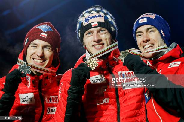Kamil Stoch of Poland takes 2nd place, Dawid Kubacki of Poland takes 1st place, Stefan Kraft of Austria takes 3rd place during the FIS Nordic World...