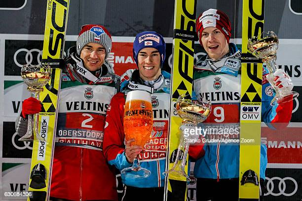 Kamil Stoch of Poland takes 2nd place Stefan Kraft of Austria takes 1st place Michael Hayboeck of Austria takes 3rd place during the FIS Nordic World...