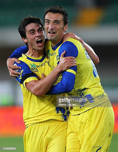 Kamil Vacek of AC Chievo Verona celebrates with his team-mate Gennaro Sardo after scoring the opening goal during the Serie A match between AC Chievo...