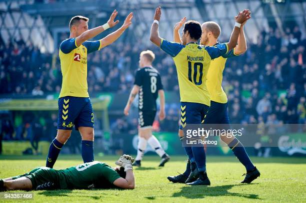Kamil Wilczek Hany Mukhtar and Teemu Pukki of Brondby IF celebrate after scoring their second goal during the Danish Alka Superliga match between...