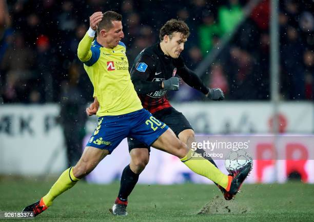 Kamil Wilczek of Brondby IF and Erik Sviatchenko of FC Midtjylland compete for the ball during the Danish Alka Superliga match between FC Midtjylland...