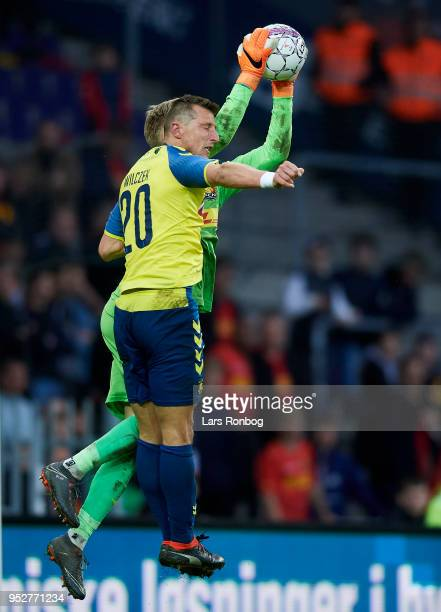 Kamil Wilczek of Brondby IF and Goalkeeper Runar Alex Runarsson of FC Nordsjælland compete for the ball during the Danish Alka Superliga match...