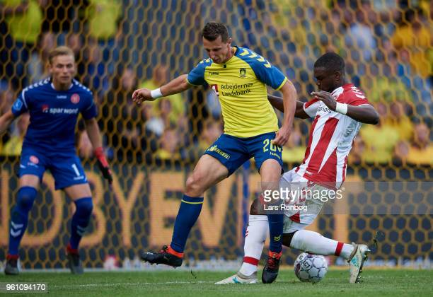 Kamil Wilczek of Brondby IF and Jores Okore of AaB Aalborg compete for the ball during the Danish Alka Superliga match between Brondby IF and AaB...