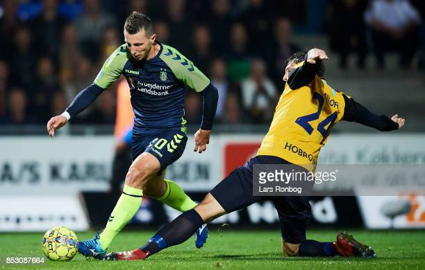 Kamil Wilczek of Brondby IF and Rasmus Minor Petersen of Hobro IK compete for the ball during the Danish Alka Superliga match between Hobro IK and...