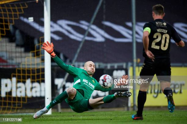 Kamil Wilczek of Brondby IF1 scores the 21 goal against Goalkeeper Matej Delac of AC Horsens during the Danish Superliga match between AC Horsens and...
