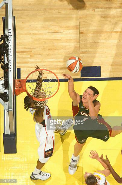 Kamila Vodichkova of the Seattle Storm shoots over Tamika Catchings of the Indiana Fever on June 28 2003 at Conseco Fieldhouse in Indianapolis...