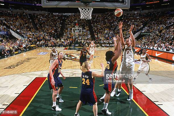 Kamila Vodichkova of the Seattle Storm shoots under pressure from Le'Coe Willingham against the Connecticut Sun in Game three of the WNBA Finals on...