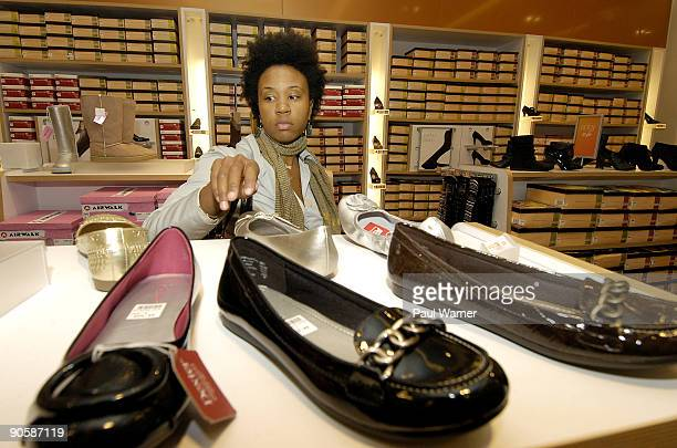 Kamilah Duggins of New York City shops for shoes at the downtown shopping party at Payless ShoeSource on September 10 2009 in New York City