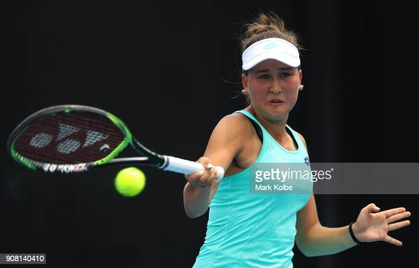 Kamilla Rakhimova of Russia plays a backhand against Ali Collins of Great Britain during the Australian Open 2018 Junior Championships at Melbourne...