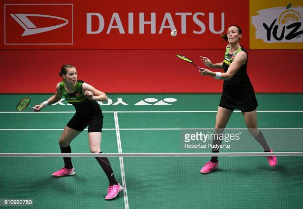 Kamilla Rytter Juhl and Christinna Pedersen of Denmark competes against Misaki Matsutomo and Ayaka Takahashi of Japan during the Women's Doubles Semi...