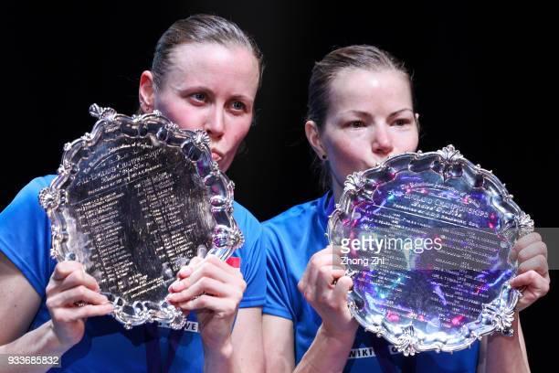 Kamilla Rytter Juhl of Denmark and Christinna Pedersen of Denmark celebrate with trophy after defeating Yuki Fukushima of Japan and Sayaka Hirota of...