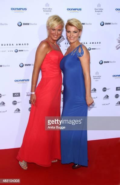 Kamilla Senjo and her sister Juliana Senjo attends the Felix Burda Award 2014 at Hotel Adlon on April 6 2014 in Berlin Germany