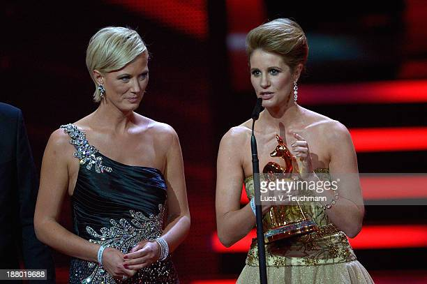 Kamilla Senjo and Karen Webb talk on stage at the Bambi Awards 2013 at Stage Theater on November 14 2013 in Berlin Germany