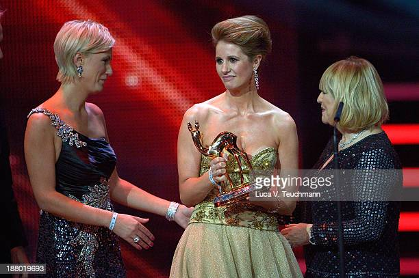 Kamilla SenjoKaren Webb and Patricia Riekel talk on stage at the Bambi Awards 2013 at Stage Theater on November 14 2013 in Berlin Germany