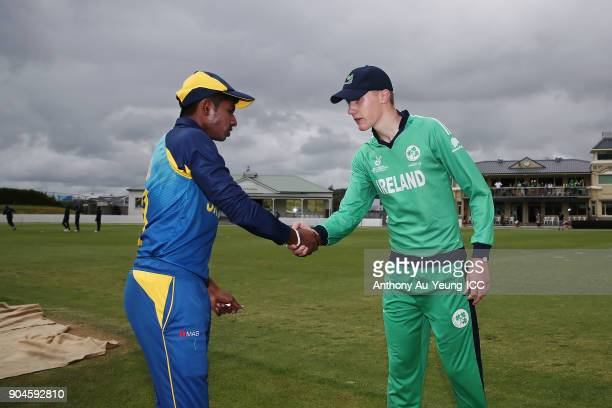 Kamindu Mendis of Sri Lanka and Harry Tector of Ireland shake hands prior to the ICC U19 Cricket World Cup match between Sri Lanka and Ireland at...