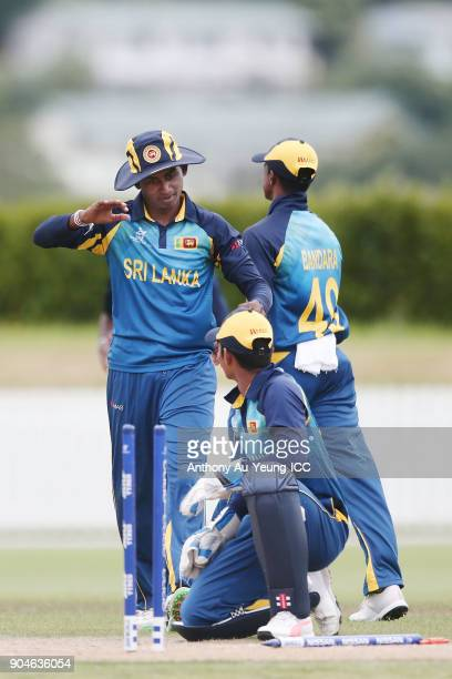 Kamindu Mendis of Sri Lanka celebrates with teammates for the wicket of Morgan Topping of Ireland during the ICC U19 Cricket World Cup match between...