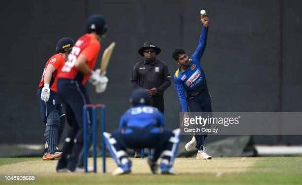 Kamindu Mendis of Sri Lanka Cricket Board XI bowls left arm over to Joe Root of England during the tour match between Sri Lanka Cricket Board XI and...