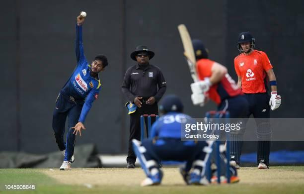 Kamindu Mendis of Sri Lanka Cricket Board XI bowls right arm over to Eoin Morgan of England during the tour match between Sri Lanka Cricket Board XI...