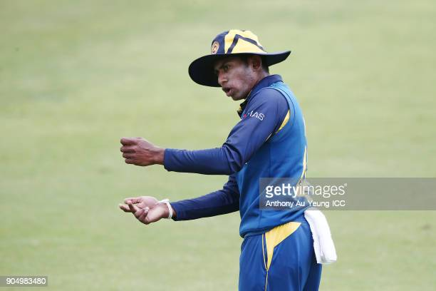Kamindu Mendis of Sri Lanka directs his team during the ICC U19 Cricket World Cup match between Sri Lanka and Ireland at Cobham Oval on January 14...