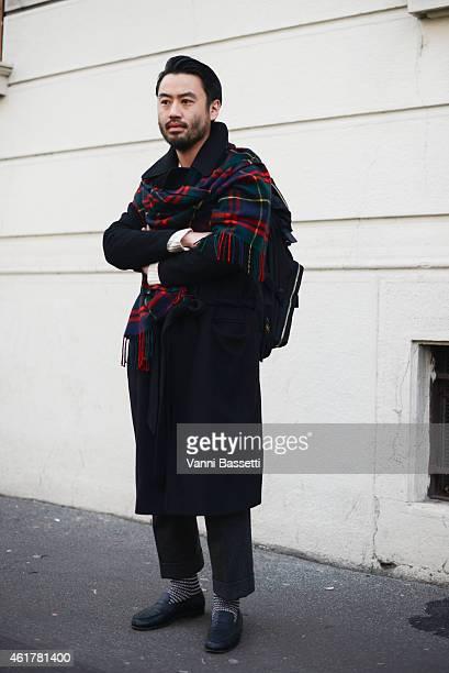 Kamiya Shitaro poses wearing an Edward Tautz coat Porter backpack and Mackintosh scarf during day 3 of Milan Menswear Fashion Week Fall/Winter...