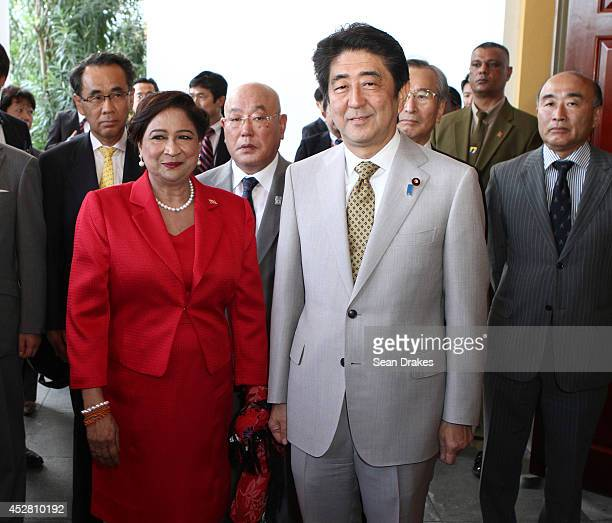 Kamla PersadBissessar Prime Minister of Trinidad and Tobago poses with His Excellency Shinzo Abe Prime Minister of Japan during a twoday visit at...