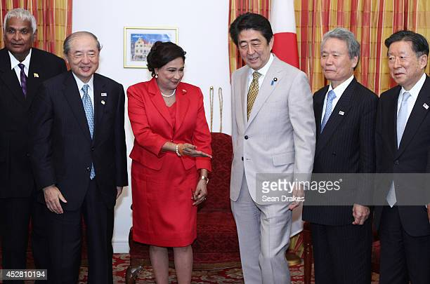 Kamla PersadBissessar Prime Minister of Trinidad and Tobago Shinzo Abe Prime Minister of Japan and Japanese business executives and Trinidad...