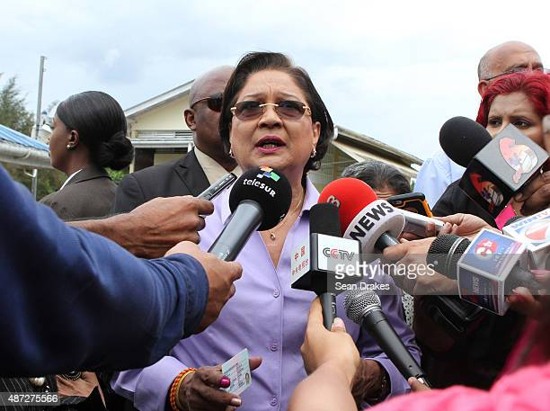 Kamla PersadBissessar Prime Minister of Trinidad Tobago talks to journalists after casting her vote at Hermitage Presbyterian School on election day...