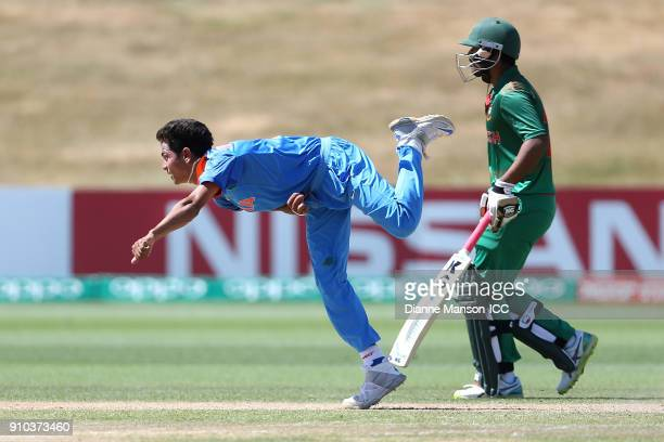 Kamlesh Nagarkoti of India bowls during the ICC U19 Cricket World Cup match between India and Bangladesh at John Davies Oval on January 26 2018 in...