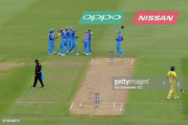 Kamlesh Nagarkoti of India is congratulated by team mates after dismissing Jason Sangha of Australia during the ICC U19 Cricket World Cup Final match...