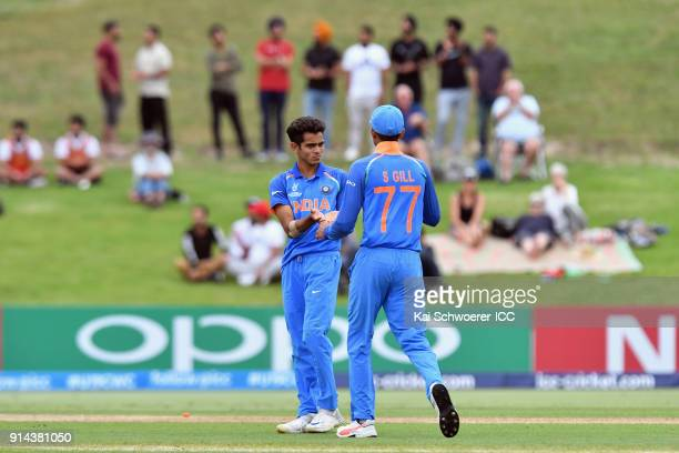 Kamlesh Nagarkoti of India is congratulated by team mates after dismissing Zak Evans of Australia during the ICC U19 Cricket World Cup Final match...