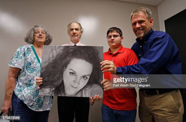 Kammey Bagwell's family mother Neta Acuna son Keeten Bagwell and fiance Mike Parsons pose with organ recipient Dwight Douglas holding the portrait of...