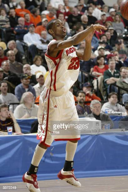 Kammron Taylor of the University of Wisconsin Badgers passes the ball against the University of Minnesota Golden Gophers during the Big Ten...