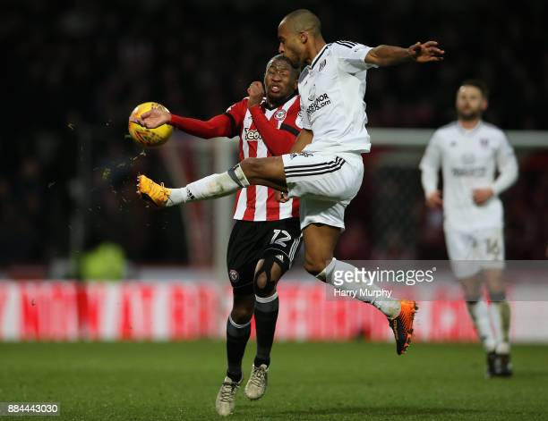 Kamohelo Mokotjo of Brentford and Denis Odoi of Fulham battle for possession during the Sky Bet Championship match between Brentford and Fulham at...