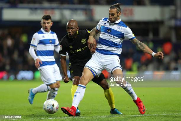 Kamohelo Mokotjo of Brentford is challenged by Geoff Cameron of Queens Park Rangers during the Sky Bet Championship match between Queens Park Rangers...