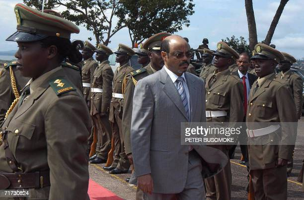 Ethiopia's Prime Minister Meles Zenawi inspects a guard of honour by Uganda's People's Defence Forces after he arrived at Kampala 28 August 2006 for...
