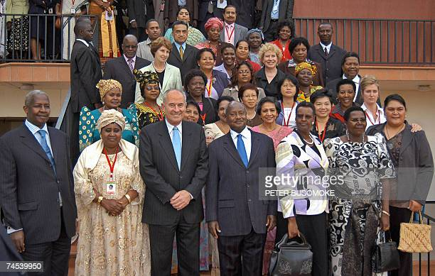 Uganda's President Yoweri Museveni and Commonwealth Secretary General Don McKinnon pose 11 June 2007 in a group picture with delegates to the three...